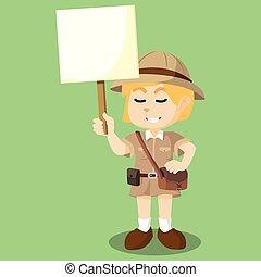 girl explorer holding sign