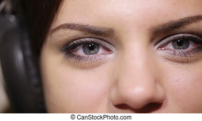 Girl eyes with headphones CU