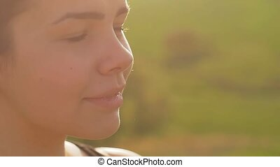 girl face rubs her eyes in the sun slow motion video - clear...