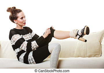 Girl fashionable dress posing on couch.