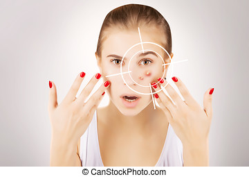 girl fights ugly skin, grey gradient background - young...