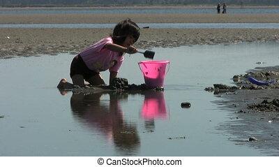 Girl Filling Up Her Bucket