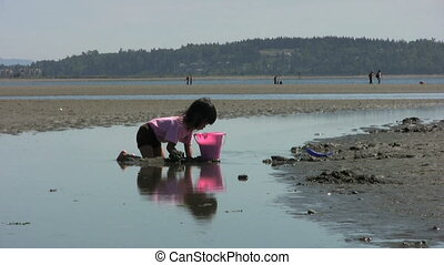 Girl Filling Up Her Bucket With San