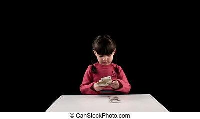 Girl finds money on black