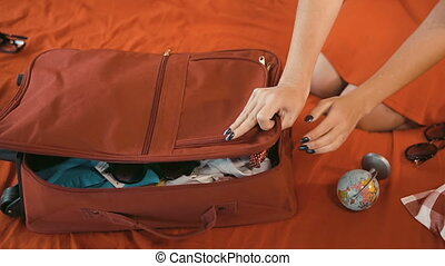 Girl Finishes Packing - Girl finishes packing red travelling...