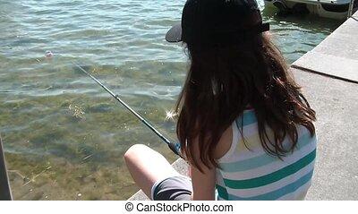 Girl Fishing Off Dock