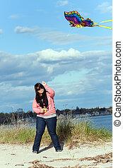 Girl Flies a Kite at the Sea Shore