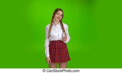 Girl flirts now . Green screen