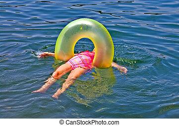 Girl Floating on Back