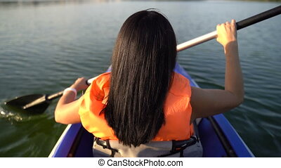 Girl floats in a kayak boat - A girl floats in a kayak boat ...