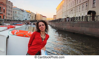 Girl floats in boat on river channel to St. Petersburg