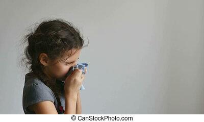 girl flu sneezes - girl teen sneezing flu into a...