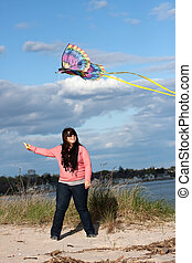 Girl Flying a Kite at the Beach