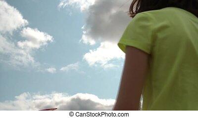 Girl Flying Kite in Sun
