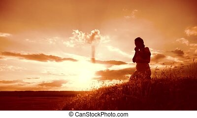Girl folded her hands in prayer lifestyle silhouette at...