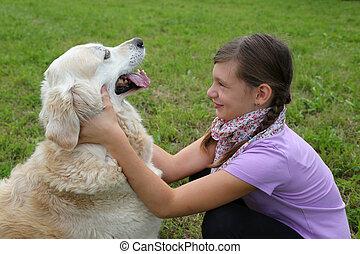 Girl fondling a dog