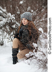 Girl for a walk  in the winter