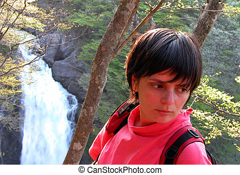 Girl forest and waterfall