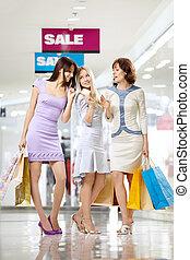 Girl-friends on shopping