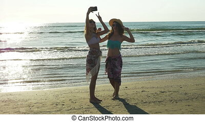 Girl friends taking a selfie on the beach