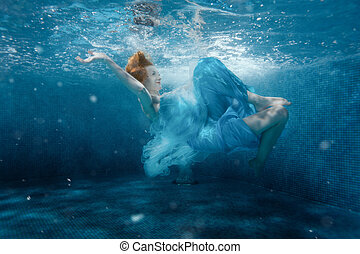 Girl from the fairy tale under water.