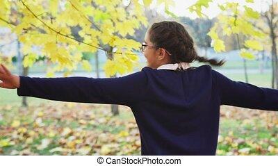 Girl fun whirl with in autumn park - Girl having fun and ...