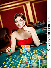 Girl gambles at the casino club