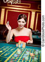 Girl gambles at the casino