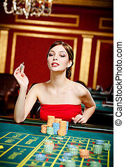 Girl gambles at the gambling house
