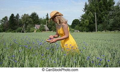 girl gather herb blooms