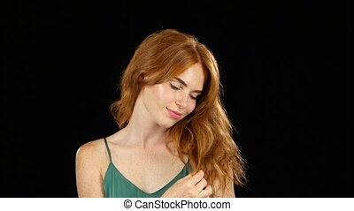 Girl genuinely smile at the camera. Black background