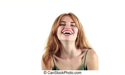 Girl genuinely smile at the camera. White background. Slow...