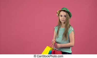 Girl gets a red shoe from the bag and she is happy . Pink...