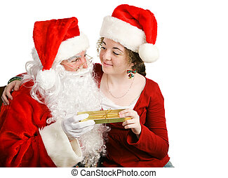Girl Gets Christmas Present From Santa