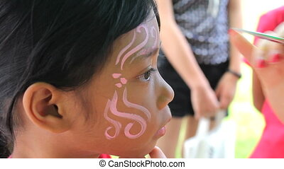 Girl Gets Face Painting At Carnival - A cute little 7 year...