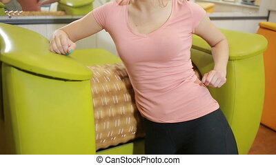 girl gets rid of cellulite and excess weight on the massager. gym