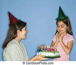 Girl getting birthday cake.
