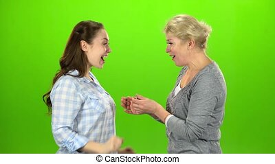 Girl gives the keys to her mom. Green screen. Side view -...