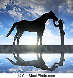 girl giving a kiss horse - Silhouette of a girl giving a...