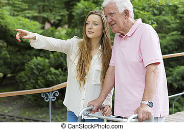 Girl giving directions to the elder man