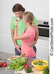 Girl giving his boyfriend a sandwich