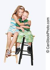 Girl giving hug to brother.