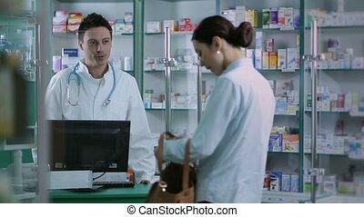 Girl giving prescription to pharmacist in pharmacy