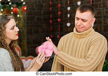 girl giving present to her man