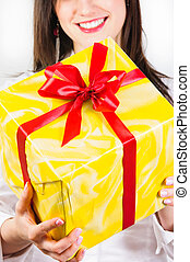 Girl giving present to you