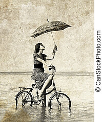 Girl go for a cycle ride at water w