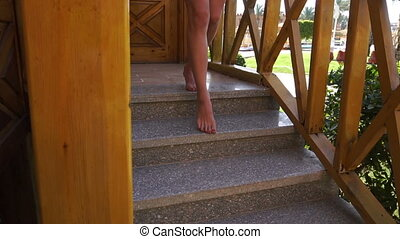 girl goes down the stairs