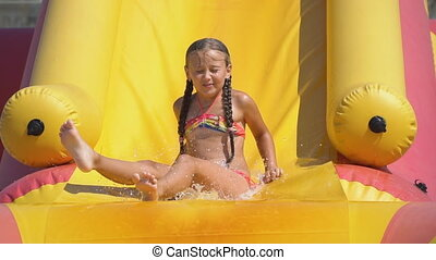 girl goes down the water slide