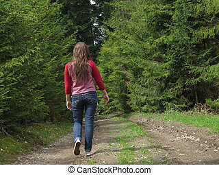 girl goes on a footpath