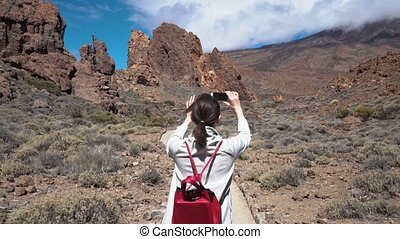 girl goes on a Hiking trail near mount Teide - Hiking with a...